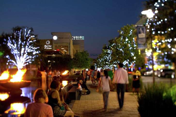 Pedestrians walk around CityCentre in West Houston