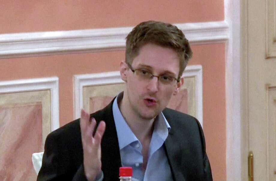 An image grab taken from a video released by Wikileaks on Oct. 12, 2013 shows U.S. intelligence leaker Edward Snowden speaking during a dinner with U.S. ex-intelligence workers and activists in Moscow on Oct. 9, 2013. (AFP PHOTO / WIKILEAKS ) Photo: -, Handout / AFP