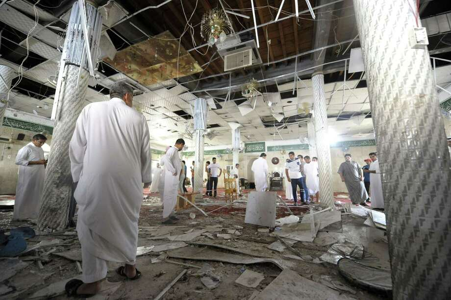 Scores were killed or wounded in the mosque attack in the Shiite town of Qatif. It marks the first time the Islamic State has claimed an attack in Saudi Arabia. Photo: STR / AFP