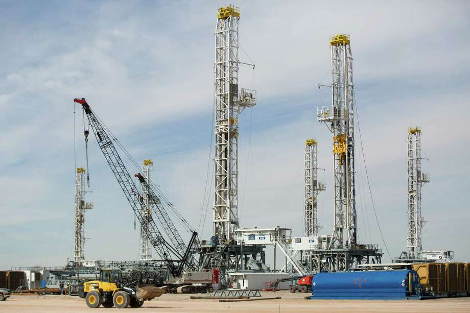 A drop in U.S. drilling that began last fall, idling rigs like these in Ector County near Odessa, has begun to ease as oil prices continue a slow climb from six-year lows in March.   (AP Photo/Odessa American, Courtney Sacco) Photo: Courtney Sacco, MBR / Odessa American