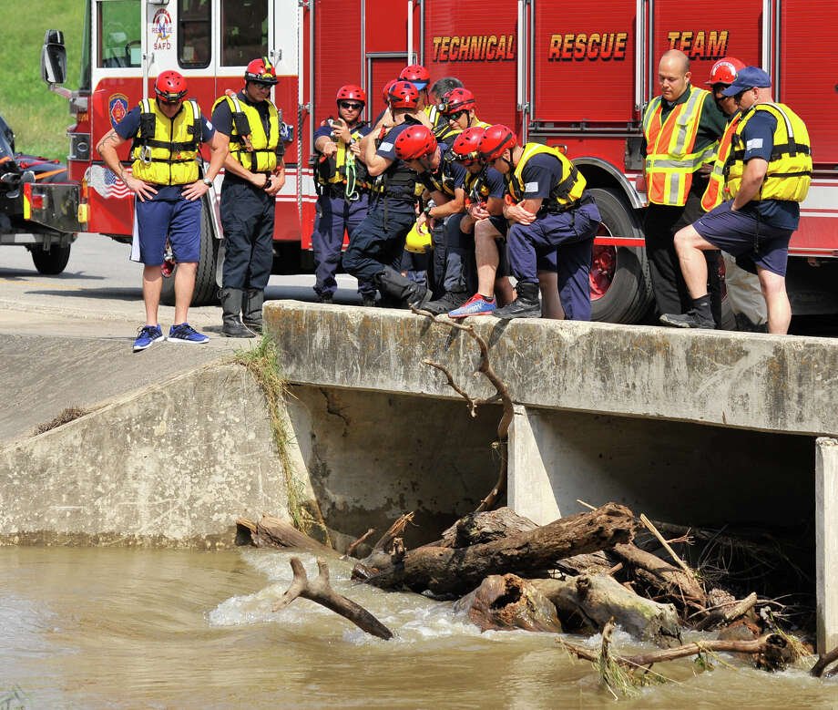 The San Antonio Fire Departments' Technical Rescue Team assess' a car that was swept away in the high water of Leon Creek near Cassin Rd. and I35 Monday afternoon. The unidentified female driver drowned. Photo: Robin Jerstad / San Antonio Express-News
