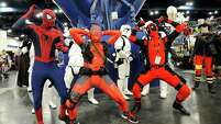 "A dance party starts as a group of Stormtroopers from ""Star Wars"" photobomb Christian Gomez, as Spider-Man, and Zack Sturts and Austin Savoie, both dressed as comics character Deadpool, at Comicpalooza."