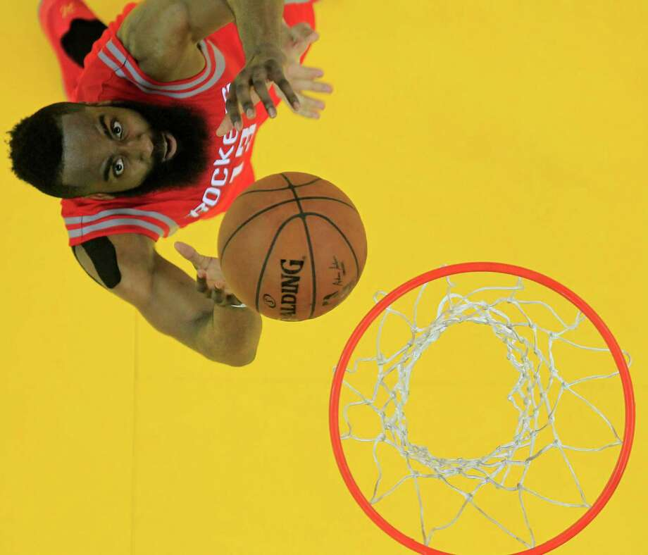 """Rather than mourning two close losses, James Harden believes having opportunities to win both games gives the Rockets """"all the confidence in the world."""" Photo: James Nielsen, Staff / © 2015  Houston Chronicle"""
