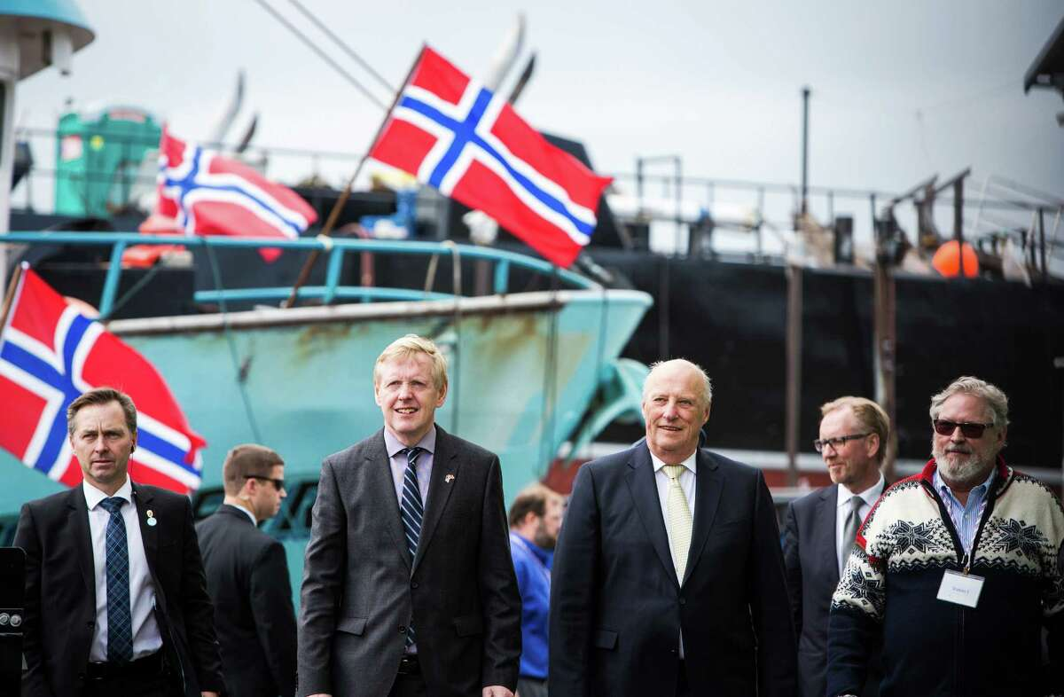 King Harald V of Norway, center right, tours the Pacific Fisherman Shipyard in Ballard on Friday, May 22, 2015. This is his first appearance during a weekend visit to Seattle where the King will give the commencement speech at Pacific Lutheran University and spend time in the Ballard neighborhood - known for its large Norwegian population.