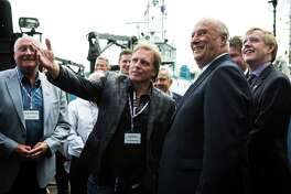 """Sig Hansen from """"The Deadliest Catch"""" talks with King Harald V of Norway at the Pacific Fisherman Shipyard in Ballard on Friday, May 22, 2015. This is his first appearance during a weekend visit to Seattle where the King will give the commencement speech at Pacific Lutheran University and spend time in the Ballard neighborhood - known for its large Norwegian population."""
