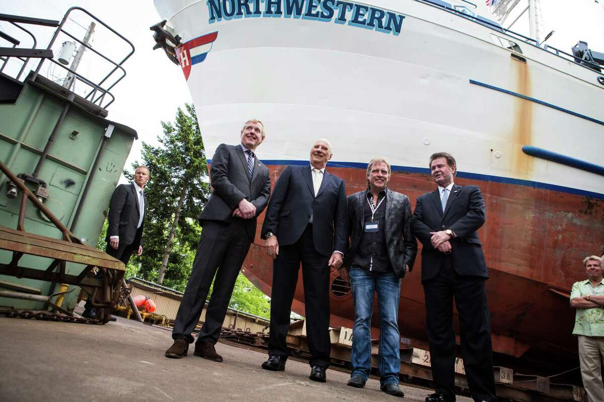 King Harald V of Norway poses with Sig Hansen in front of Hansen's ship, the Northwestern, featured on