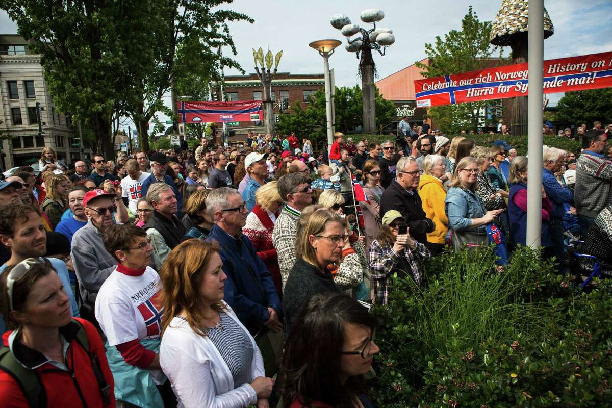 Community members gather to see King Harald V of Norway in Ballard on Friday, May 22, 2015. This is the King's first appearance during a weekend visit to Seattle where the King will give the commencement speech at Pacific Lutheran University and spend time in the Ballard neighborhood - known for its large Norwegian population.