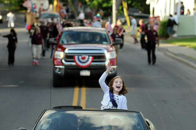 Poppy Queen Julia Boularis, 10, center, waves from the back of a convertible during the Annual American Legion Post 490's Memorial Day Parade on Friday, May 22, 2015, in Stillwater, N.Y. (Cindy Schultz / Times Union) Photo: Cindy Schultz / 00031937A