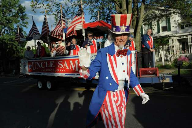 Uncle Sam, also known as Fred Polnisch, center, and the Uncle Sam Chorus join the Annual American Legion Post 490's Memorial Day Parade on Friday, May 22, 2015, in Stillwater, N.Y. (Cindy Schultz / Times Union) Photo: Cindy Schultz / 00031937A