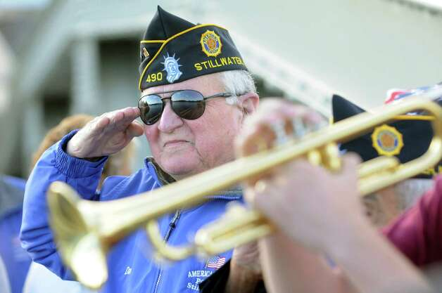 "Dan Gibeault salutes during the playing of ""Taps"" as part of the Annual American Legion Post 490's Memorial Day Parade on Friday, May 22, 2015, in Stillwater, N.Y. (Cindy Schultz / Times Union) Photo: Cindy Schultz / 00031937A"