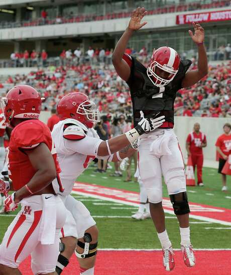 Quarterback Greg Ward Jr. (1) celebrates after rushing for touchdown against the red team during the Spring Red and White game on April 18, 2015 at TDECU Stadium in Houston, TX. White won 24 to 11. (Photo: Thomas B. Shea/For the Chronicle) Photo: Thomas B. Shea, Freelance / For The Chronicle / © 2015 Thomas B. Shea