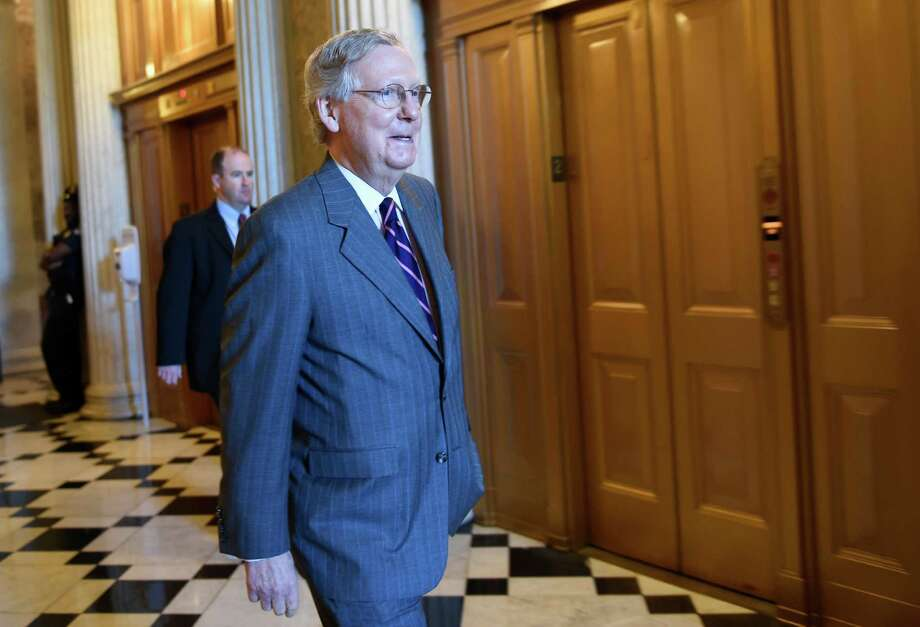 Senate Majority Leader Mitch McConnell of Ky. walks to a Republican luncheon on Capitol Hill in Washington, Friday, May 22, 2015. Supporters of President Barack Obama's trade agenda hope to fend off hostile Senate amendments Friday and send a major trade bill to the House, where another fierce debate awaits. Senators also plan to address the government's soon-to-expire authority to collect bulk data on Americans' phone records. (AP Photo/Susan Walsh)  ORG XMIT: DCSW101 Photo: Susan Walsh / AP