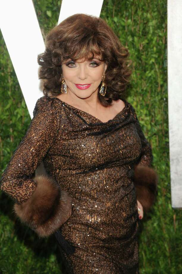 Actress Joan Collins arrives at the 2013 Vanity Fair Oscars Viewing and After Party, Sunday, Feb. 24 2013 at the Sunset Plaza Hotel in West Hollywood, Calif. (Photo by Evan Agostini/Invision/AP) Photo: Evan Agostini / Invision