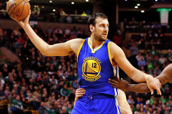 Golden State Warriors' Andrew Bogut during the first quarter of an NBA basketball game against the Boston Celtics in Boston Sunday, March 1, 2015. (AP Photo/Winslow Townson)
