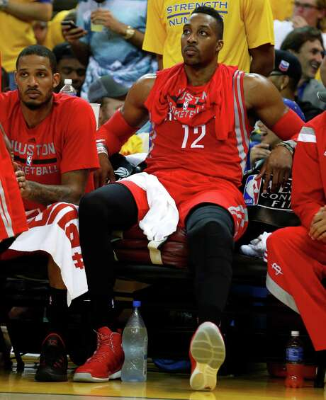 Despite nursing a sprained left knee, Rockets center Dwight Howard spent little on the bench in Game 2, getting 19 points and 17 rebounds in 40 minutes. Photo: James Nielsen, Staff / © 2015  Houston Chronicle
