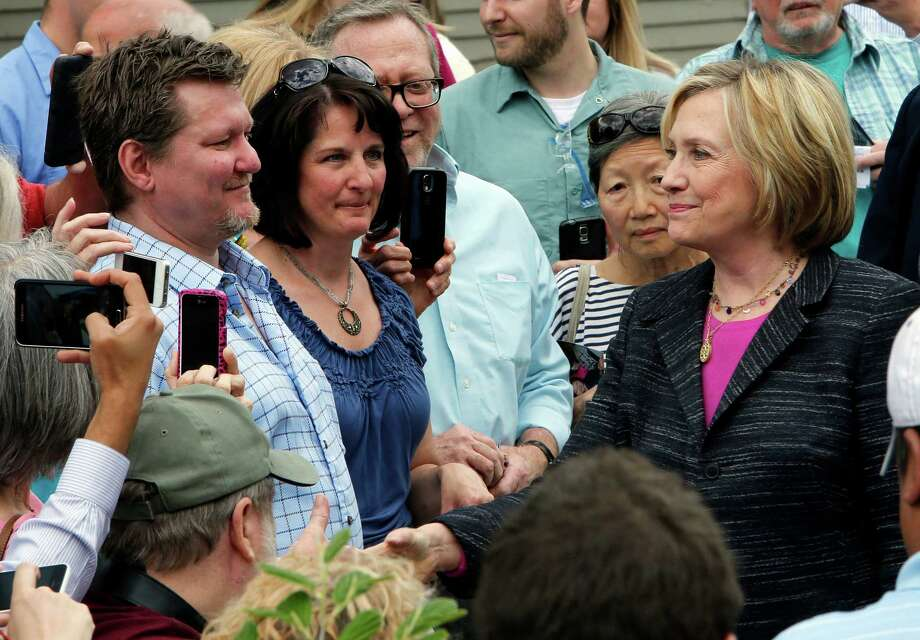Democratic presidential candidate Hillary Rodham Clinton shakes hands after touring the Smuttynose Brewery, Friday, May 22, 2015, in Hampton, N.H. (AP Photo/Jim Cole) ORG XMIT: NHJC112 Photo: Jim Cole / AP