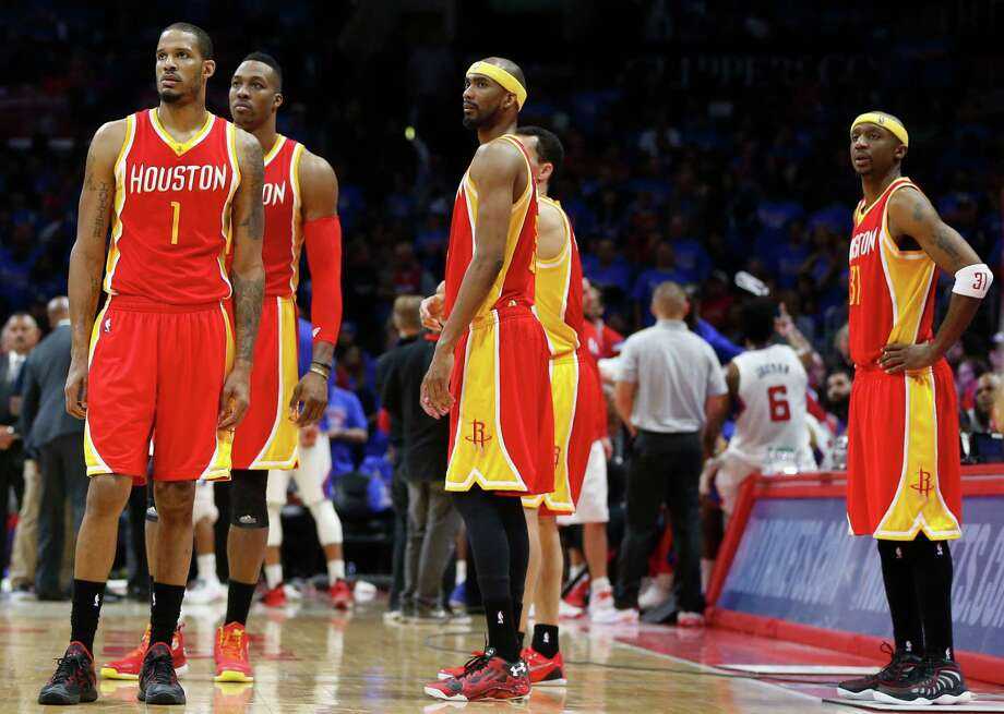Houston Rockets forward Trevor Ariza (1), center Dwight Howard (12), guard Corey Brewer (33) and guard Jason Terry (31) stand on the court near the end of the second half of Game 3 of the NBA Western Conference semifinals against the Los Angeles Clippers at Staples Center Friday, May 8, 2015, in Los Angeles.  ( James Nielsen / Houston Chronicle ) Photo: James Nielsen, Staff / © 2015  Houston Chronicle