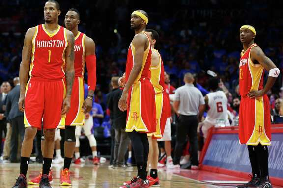 Houston Rockets forward Trevor Ariza (1), center Dwight Howard (12), guard Corey Brewer (33) and guard Jason Terry (31) stand on the court near the end of the second half of Game 3 of the NBA Western Conference semifinals against the Los Angeles Clippers at Staples Center Friday, May 8, 2015, in Los Angeles.  ( James Nielsen / Houston Chronicle )