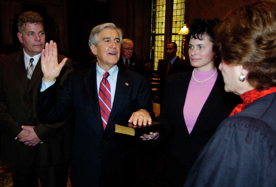 Times Union Staff by Skip Dickstein - Senator Joe Bruno is sworn in by the Chief Judge of the Court of Appeals Judith Kaye(r) as his daughter Susan Bruno holds the bible and his son looks on(far left) Photo: SKIP DICKSTEIN / ALBANY TIMES UNION