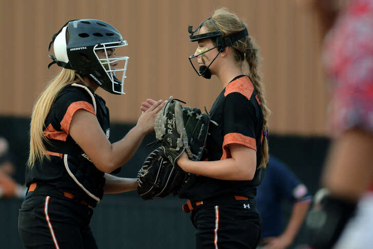 Alvin senior catcher Alyssa Moscot, left, pumps up Yellow Jacket freshman pitcher Rachel Hertenberger between hitters against Katy in the top of the 4th inning of game 2 of their Class 6A Regional Semifinal Softball Playoff series at Alvin High School on Friday, May 22, 2015. (Photo by Jerry Baker/Freelance)