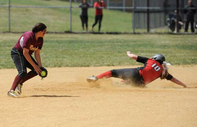Guilderland Torie Rathwell is safe after sliding into second base during a Class AA quarterfinal softball game against Colonie on Friday, May 22, 2015 in Colonie, N.Y. (Lori Van Buren / Times Union) Photo: Lori Van Buren / 00031969A