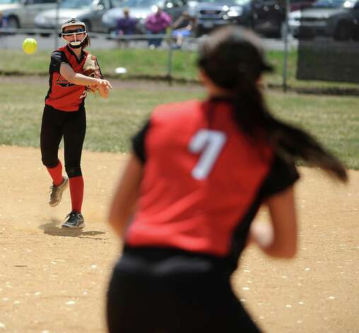 Guilderland second baseman Baily Cummings throws the ball to Madison Harrigan for the out at first base during a Class AA quarterfinal softball game against Colonie on Friday, May 22, 2015 in Colonie, N.Y. (Lori Van Buren / Times Union) Photo: Lori Van Buren / 00031969A