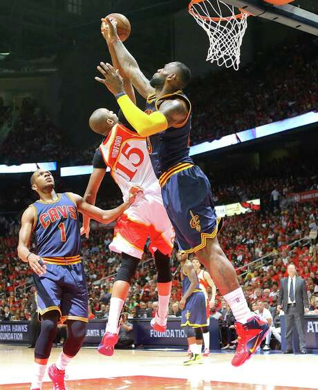 The Cavaliers' LeBron James blocks a shot by the Hawks' Al Horford in Game 2 of the Eastern Conference finals Friday night. Photo: Curtis Compton, MBR / Atlanta Journal-Constitution