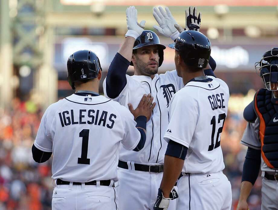 Former Astro J.D. Martinez, center, celebrates with his Tigers teammates after launching a three-run home run in the third inning Friday night. Photo: Gregory Shamus, Stringer / 2015 Getty Images