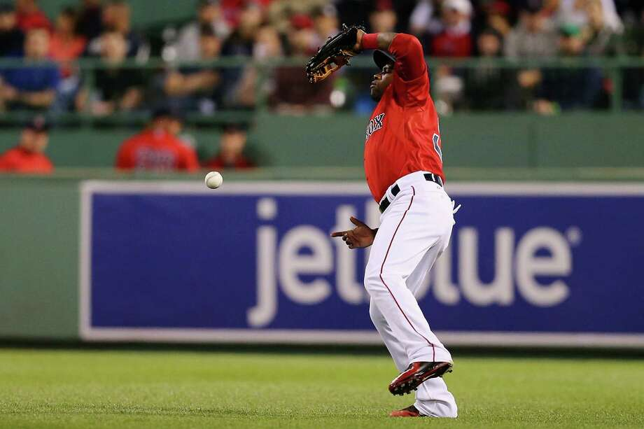 BOSTON, MA - MAY 22:  Rusney Castillo #38 of the Boston Red Sox commits an error trying to catch a fly ball during the fifth inning against the Los Angeles Angels of Anaheim at Fenway Park on May 22, 2015 in Boston, Massachusetts.  (Photo by Maddie Meyer/Getty Images) ORG XMIT: 538580831 Photo: Maddie Meyer / 2015 Getty Images