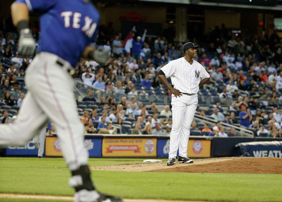 New York Yankees starting pitcher Michael Pineda reacts as Texas Rangers' Mitch Moreland runs the bases after hitting a home run during the third inning of a baseball game Friday, May 22, 2015, in New York. (AP Photo/Frank Franklin II) ORG XMIT: NYY112 Photo: Frank Franklin II / AP
