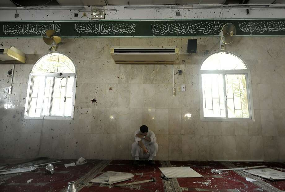 A Saudi man reacts following a blast inside a mosque, in the mainly Shiite Saudi Gulf coastal town of Qatif, 400 kms east of Riyadh, on May 22, 2015. A suicide bomber targeted a Shiite mosque during Friday prayers in Kudeih in Shiite-majority Qatif district, the interior ministry said, with activists saying at least four worshippers were killed. Photo: Str, AFP / Getty Images