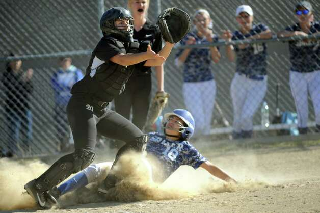 Shaker's Kaitlyn Berghela beats the ball home as she slides under Bethlehem catcher Kaitlyn Rarick during their softball game on Friday, May 22, 2015, at Shaker High in Latham, N.Y. (Cindy Schultz / Times Union) Photo: Cindy Schultz / 00031940A
