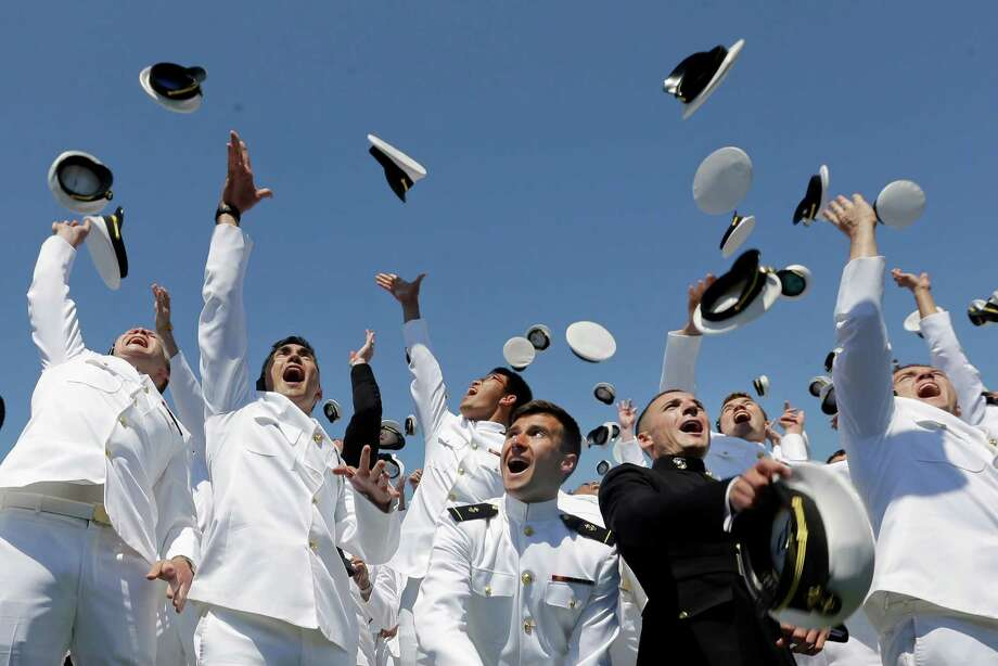 Graduating members of the U.S. Naval Academy throw their covers in the air at the end of the Academy's graduation and commissioning ceremony, Friday, May 22, 2015, in Annapolis, Md. (AP Photo/Patrick Semansky) Photo: Patrick Semansky, Associated Press / AP
