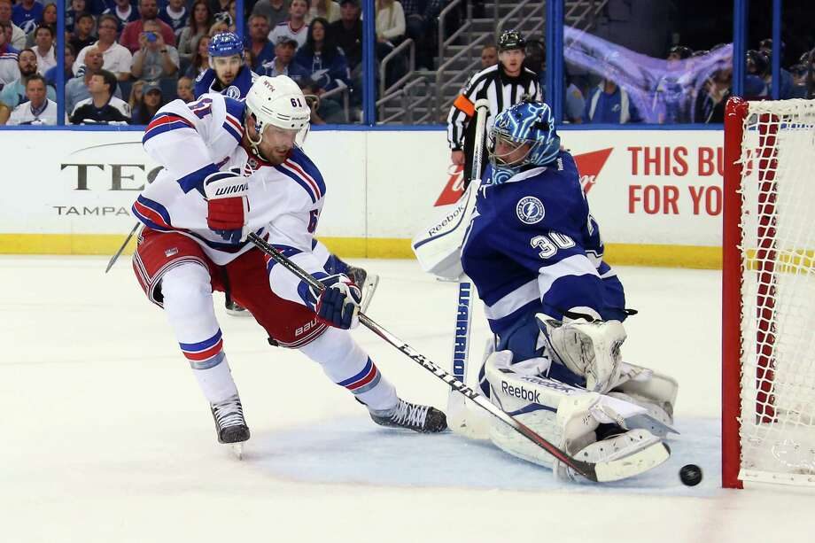 TAMPA, FL - MAY 22:  Rick Nash #61 of the New York Rangers scores a goal during the first period against Ben Bishop #30 of the Tampa Bay Lightning in Game Four of the Eastern Conference Finals during the 2015 NHL Stanley Cup Playoffs at Amalie Arena on May 22, 2015 in Tampa, Florida.  (Photo by Bruce Bennett/Getty Images) ORG XMIT: 554342855 Photo: Bruce Bennett / 2015 Getty Images