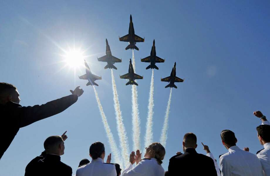 Commander Eric Doyle, a League City native and Texas A&M graduate, has been chosen to be the next leader of the Blue Angels, the U.S. Navy's famed flight demonstration team.Keep clicking to see more images of the U.S. Navy's Blue Angels Photo: Patrick Semansky, Associated Press / AP