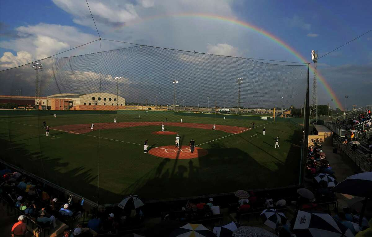 A rainbow appears over the baseball field at Blossom Athletic Complex during a high school playoff game between Johnson and O'Connor on Friday, May 22, 2015. (Kin Man Hui/San Antonio Express-News)