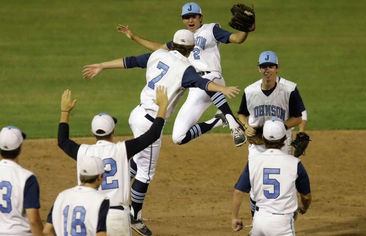 Johnson Jaguars Hunter Trinidad (2) and Garrett Acker (7) join the team to celebrate after defeating the O'Connor Panthers, 9-3, in Game 2 to finish off their 6A third-round series at Blossom Athletic Complex on May 22, 2015.