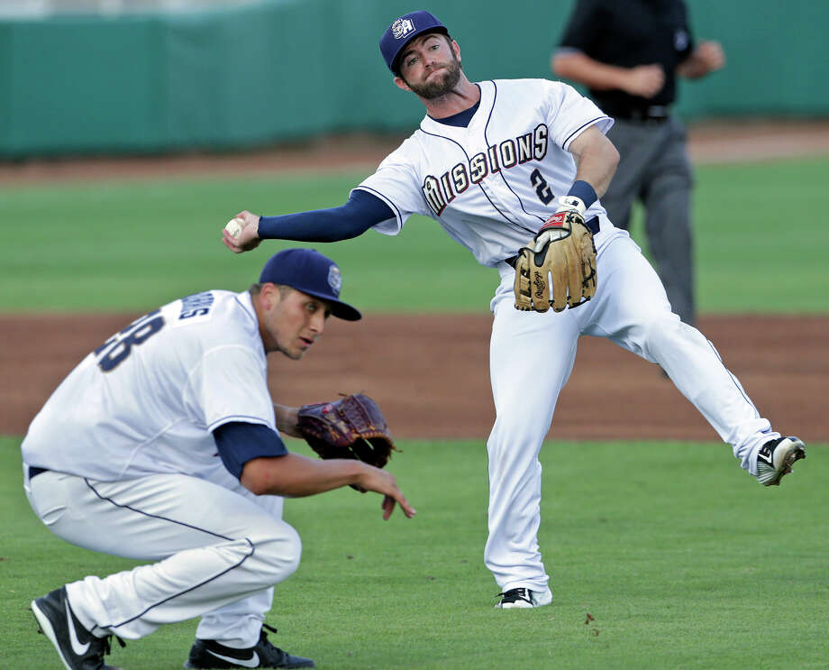 Pitcher Elliott Morris while Mission second baseman Casey McElroy tries to throw out a runner in the second inning as the Missions host the Frisco Roughriders at Wolff Stadium on May 22, 2015. Photo: Tom Reel / San Antonio Express-News