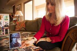 Janna Hoehn at home in Kihei on Maui on 5.22.15. Hoehn is going through images of fallen Vietnam War soldiers sent to her by families all over the country. Hoehn photographed in her