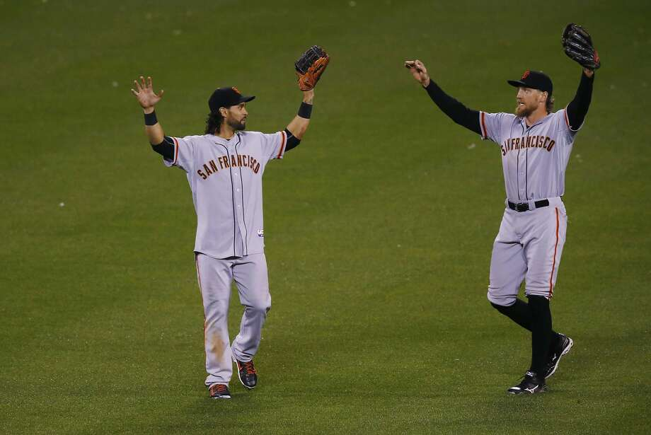 San Francisco Giants center fielder Angel Pagan, left, celebrates with San Francisco Giants right fielder Hunter Pence after the Giants retired the Colorado Rockies in the bottom of the ninth inning of a baseball game Friday, May 22, 2015, in Denver. The Giants won 11-8. (AP Photo/David Zalubowski) Photo: David Zalubowski, Associated Press