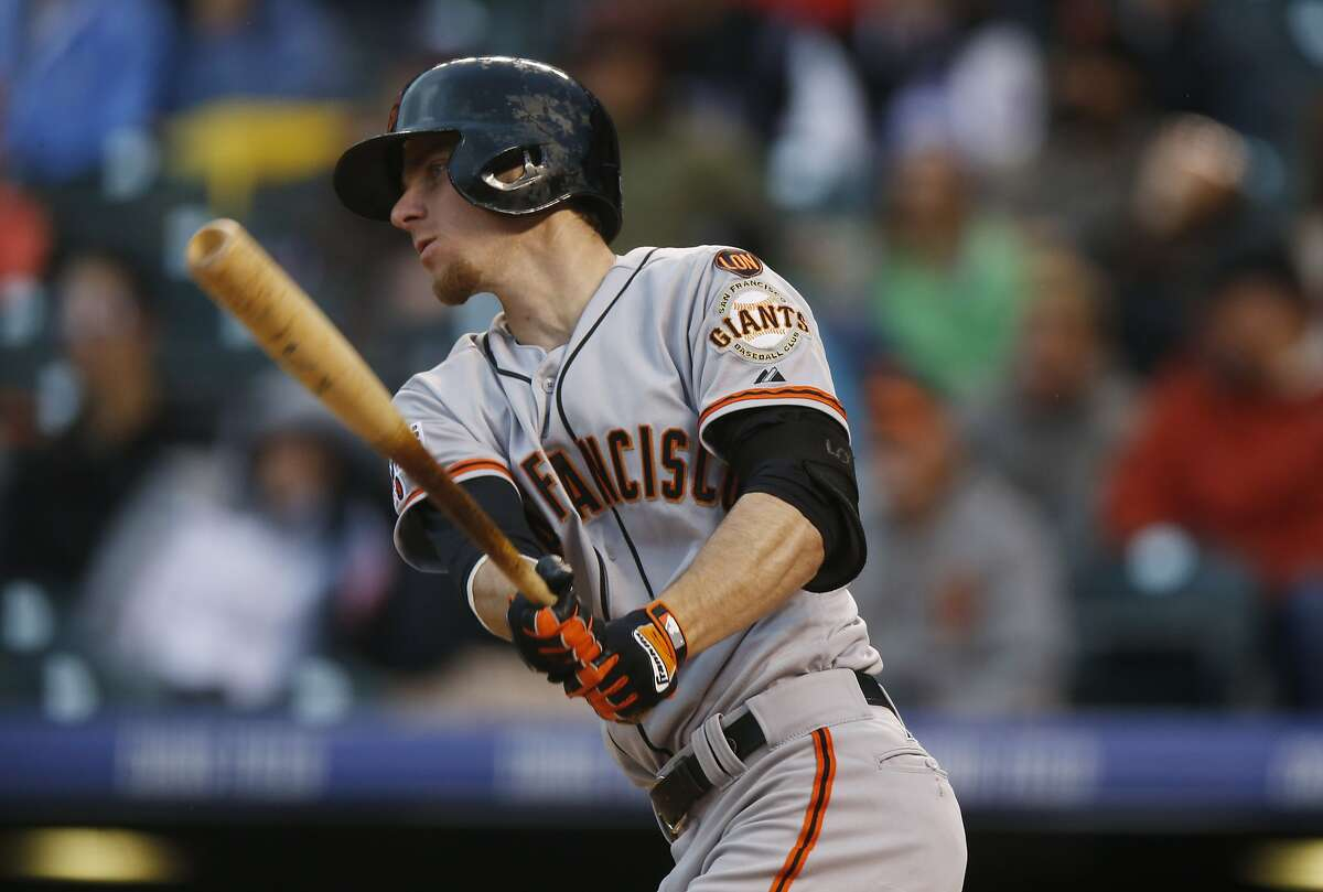 San Francisco Giants third baseman Matt Duffy flies out against Colorado Rockies starting pitcher Kyle Kendrick in the fourth inning of a baseball game Friday, May 22, 2015, in Denver. The Giants won 11-5. (AP Photo/David Zalubowski)