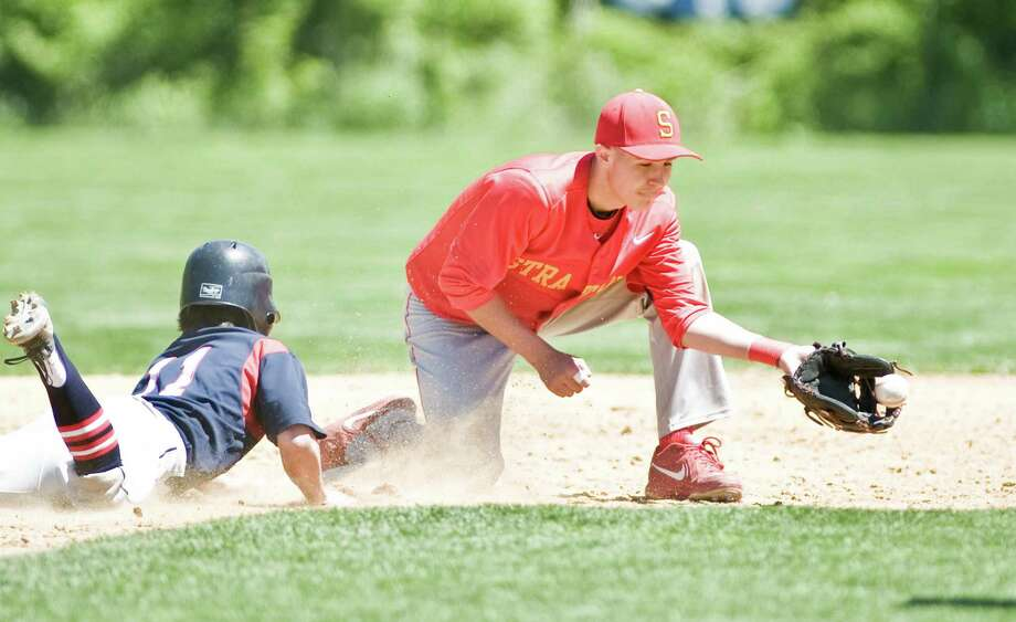 New Fairfield High School's Alex Hooper dives back to 2nd as Stratford High School's Brett Cody takes the throw in the SWC baseball quarterfinals played at New Fairfield. Saturday, May 23, 2015 Photo: Scott Mullin / The News-Times Freelance