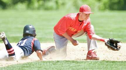 New Fairfield High School's Alex Hooper dives back to 2nd as Stratford High School's Brett Cody takes the throw in the SWC baseball quarterfinals played at New Fairfield. Saturday, May 23, 2015
