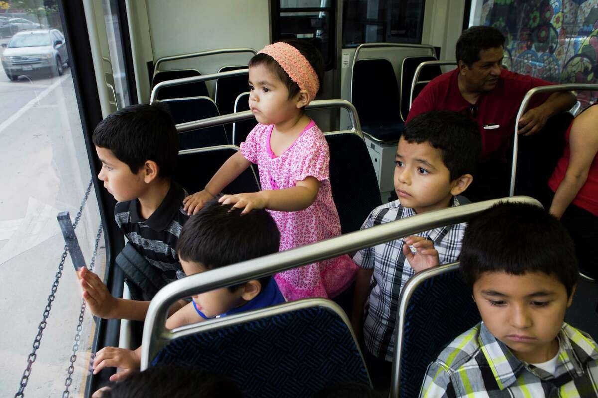 Adrian Dean, left, 11, Ariel Dean, 3, Nathan Dean, 5, Leonidas Dean, 6 and Lorenzo Dean, right, 8, ride the Green Line during the first day the line was open to the public, May 23, 2015.