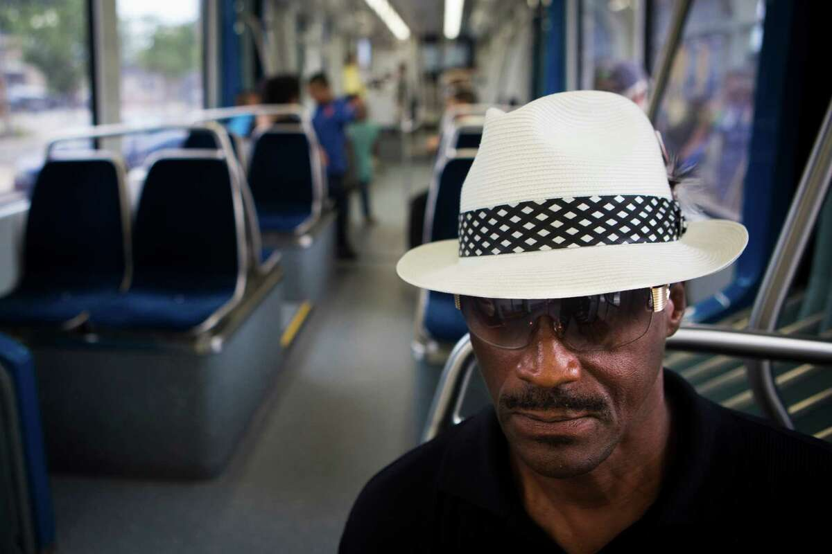 Randy Hayes a frequent Metro user, rides the Green Line on its opening day, May 23, 2015.