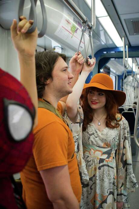 Kelly Fletcher, right, William Greenshield and Billy Greenshield, left, ride the Green Line Metro on their way to the George R. Brown Convention Center for Comicpalooza on Saturday. Photo: Marie D. De Jesus, Houston Chronicle / © 2015 Houston Chronicle