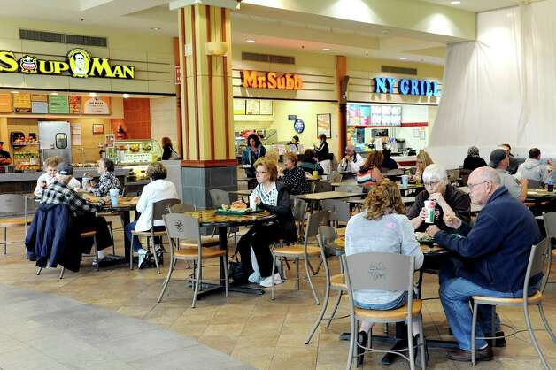 Shoppers at lunchtime in the food court on Wednesday, May 20, 2015, at Colonie Center in Colonie, N.Y. (Cindy Schultz / Times Union) Photo: Cindy Schultz / 00031908A