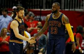 ATLANTA, GA - MAY 22:  LeBron James #23 and Matthew Dellavedova #8 of the Cleveland Cavaliers react in the third quarter against the Atlanta Hawks during Game Two of the Eastern Conference Finals of the 2015 NBA Playoffs at Philips Arena on May 22, 2015 in Atlanta, Georgia. NOTE TO USER: User expressly acknowledges and agrees that, by downloading and or using this Photograph, user is consenting to the terms and conditions of the Getty Images License Agreement.  (Photo by Kevin C. Cox/Getty Images)