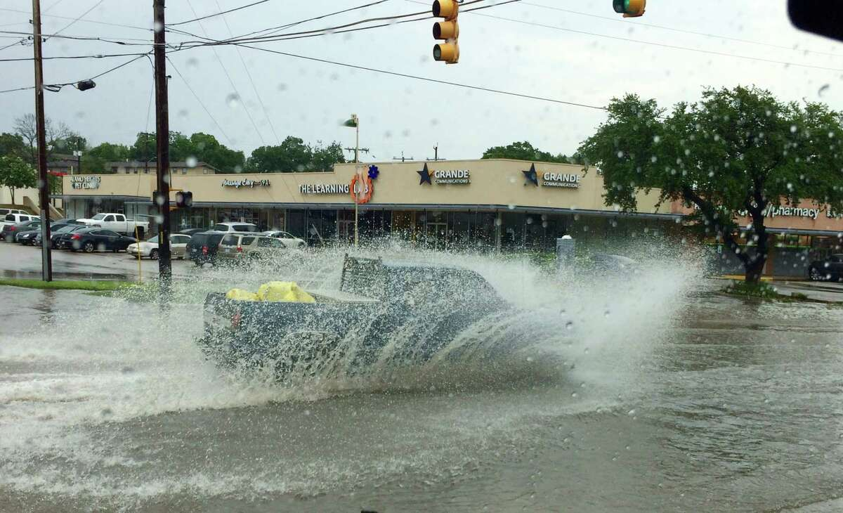 Streets flood at the intersection of Castano and New Braunfels avenues.