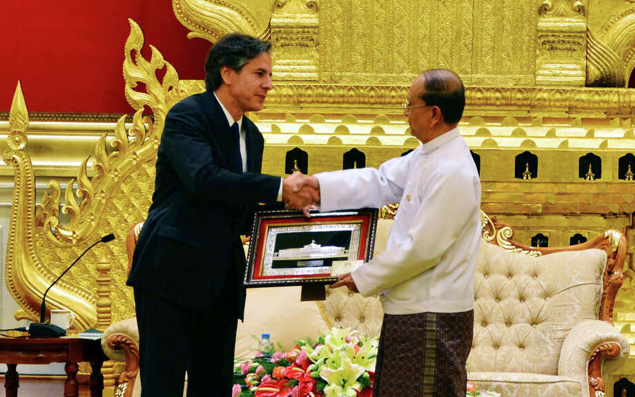 FILE - In this Thursday, May 21, 2015 file photo, Myanmar President Thein Sein, right, shakes hands with U.S. Deputy Secretary of State Antony Blinken as he presents gift during their meeting at Presidential Palace in Naypyitaw, Myanmar. Thein Sein has signed off on a law requiring some mothers to space their children three years apart despite objections by Blinken and rights activists, who worry it could be used not only to repress women, but also religious and ethnic minorities. The Population Control Health Care Bill - drafted under pressure from hard-line Buddhist monks with a staunchly anti-Muslim agenda - was passed by parliamentarians last month. (AP Photo/File) Photo: STR / AP
